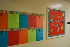 Student work display - laminate construction paper and hot glue clothespin = LESS STAPLES!