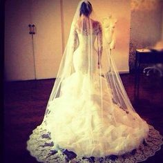Who. Makes. This. Dress. Lace top long sleeve ruffle trumpet style wedding dress