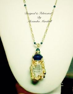 """She loves this Art Nouveau style freeform 14K gold wire wrapped Guerlain perfume bottle accentuated with Lapis and Swarovski crystal by Alexandra Marshall. Suspended from a 24"""" 14K gold and Lapis chain, this piece was custom made for Lisa. For information about a similar piece in your choice of materials, reference piece #CN1806 when contacting me via my website."""