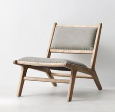 RH TEEN's Cantor Lounge Chair:Like the iconic midcentury pieces that inspired it, our low-profile lounge chair exhibits the clean lines and rectilinear angles that made the period famous –  and still look fresh today. Hand-hammered upholstery tacks outline the padded seat and back.