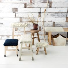 """""""Benchwarmer"""" has no negative connotations here. Soft, bulky yarn makes comfortable woolen covers for wooden stools. These call for a slight variation on the simple rectangle: Each cover is shaped like a cross with very short arms that are then folded down and stitched to make the corners."""