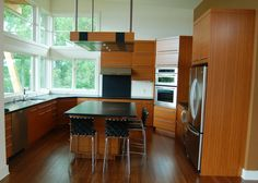 Caramel coloured bamboo with lots of natural light make this kitchen an inviting place to prepare food, or just take in the view