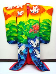 Tsuru / Crane in Japanese Kimono very bright blue, green, yellow, and orange with cranes or storks