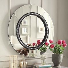 We love this chic mirror to place into a home office accented with season appropriate floral arrangements.