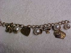 7 inch gold tone charm bracelet with heart bow crown by designer2, $10.00