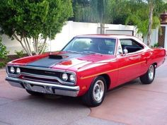 "1970 Plymouth Road Runner in ""Rallye Red."""
