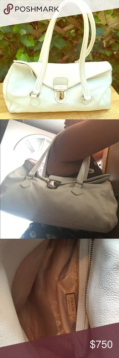Prada shoulder bag White genuine leather, hardware all intact with Prada engraved. Snaps closed, inside is clean, slight wear but nothing torn or ripped, no holes, no stains. This bag is absolutely stunning! Fits plenty! Prada Bags Hobos
