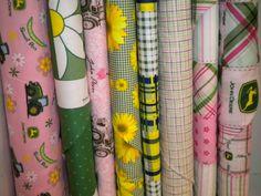 http://www.ilovesewingonline.com/shop/Fabric/Novelty/John-Deere.htm