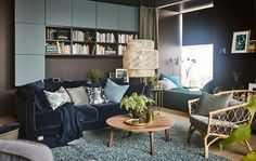 A dream living room for IKEA envisioned by Åsa Dyberg, one of Sweden's top interior designers. The result is a cosy 'do it all' space with a velvet sofa in dark blue, a walnut coffee table, and a daybed with a green curtain that allows for privacy.