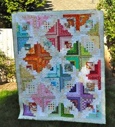 Blogger's Quilt Festival: Converging Corners Quilt -- oh my, I love this riff on the Log Cabin.