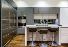 Poggenpohl // Manchester studio gray, white + stainless steel kitchen