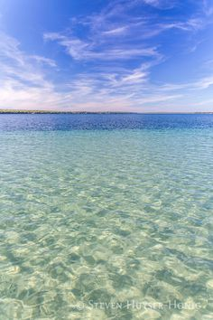 """Higgins Lake sandbar in northern #MIchigan Photographer Steven Huyser-Honig wrote: """"The native Ojibwe called it Majinabeesh–sparkling water-a fitting name for this large spring fed lake in Northern Michigan now known as Higgins Lake. Along the south shore a shallow sandy bottom stretches hundreds of feet from shore before reaching an abrupt drop off. I let my canoe drift in the gentle breeze while I captured shots of the dappled sunshine on the shallow sand bottom."""""""