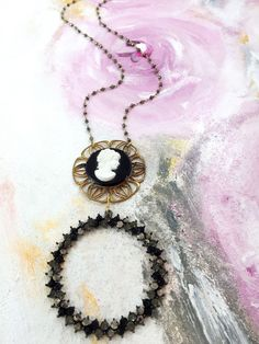 """Stand Beside"" - 1950's cameo brooch paired with rhinestone circular pendant on pyrite beaded chain"