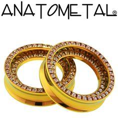 Super Orbit Eyelets in titanium, anodized copper; champagne zirconia gems