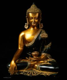 """This Buddha is crafted in the Thai style. The Buddha assumes the pose sometimes called """"Calling the Earth to Witness the Enlightenment."""" The pot of herbs in the palm sometimes leads this pose to be called """"The Medicine Buddha."""" The figure shows exquisite detail and a depth of expression."""