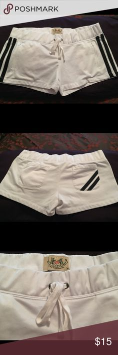 💠JUICY COUTURE Athletic Nylon Shorts💠 Juicy Couture athletic nylon shorts. Whit with black accent stripes. Front tie ~ 2 front zipper pockets ~ 2 back open pockets. Pre-loved EUC Juicy Couture Shorts