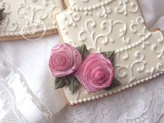 Learn how to decorate a wedding cake cookie with edible wafer paper roses in this tutorial by SweetAmbs!