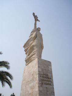 Mother Albania, a 12 m statue located at the National Martyrs Cemetery of Albania dedicated in 1971. There are 28,000 graves of Albanian partisans in the cemetery, all of whom perished during World War II.