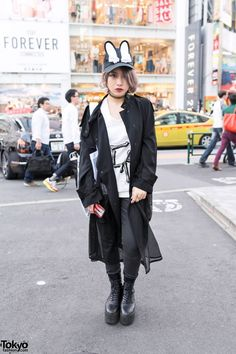Niya is a Bunka Fashion College student who we met in #Harajuku. Her look features a 101 Showroom coat with a #Vivienne #Westwood top, an #Opening #Ceremony mesh tote bag, and #Tokyo #Bopper platform boots. #tokyofashion #streetsnaps