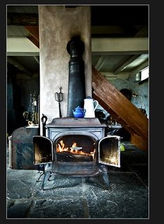 wood stove, nothing heats better.