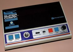 Vintage Super Cobra Electronic Handheld Game By Entex Electronics, Model 6085, VFD Screen, Made In Taiwan, Copyright 1982.