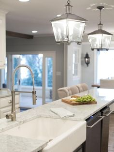 As seen on HGTV's Fixer Upper, French country chandeliers bring character to this lovely white kitchen. French Country Kitchens, Farmhouse Style Kitchen, French Country Decorating, Country French, Farmhouse Ideas, Country Style, Fixer Upper Kitchen, New Kitchen, Kitchen Island