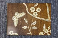 Marquetry sample in walnut with different coloured mother of pearl to give depth to the design.