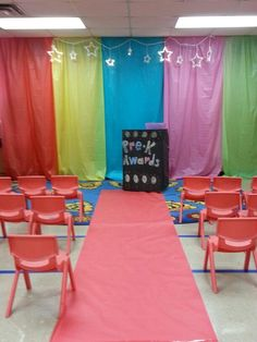 My class decorated for end of year awards. Red carpet and $1 plastic table cloths as a backdrop