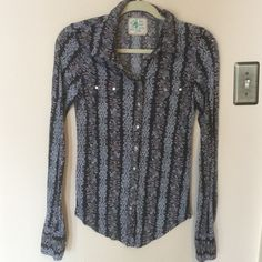 Free People Snap Button Up Boho Blouse Love the pattern and colors. Slim fit and longer fit. Buttons are snaps. Darkest color is black. Purchased on Posh and found the sleeves a bit too long but was listed as having never been worn. So cute Free People Tops Button Down Shirts