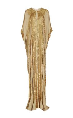 This silk **Naeem Khan** caftan features a high round neck with a keyhole design at the front, metallic beading in a striped design throughout the bodice, and a draped floor length silhouette.