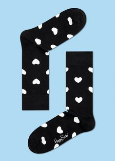 Putting on a pair of heart socks is the perfect way to finish off an outfit. Adding some love to an otherwise bland pair of black socks, the white hearts give women and men alike something to smile about. Woven from the finest combed cotton, the highest quality of cozy comfort is ensured. Colorful · Witty · Lively. PATTERN: Hawaii, COMPOSITION 54% Combed Cotton, 43% Polyamide, 3% Elastane. www.HappySocks.com