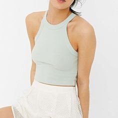 Urban Outfitters High Neck Crop Top Comfy and cute stretchy high neck crop top in a light green/mint color. A perfect basic for spring and summer, and the light green color is a different take on a neutral color. Size XS, new with tags Urban Outfitters Tops Crop Tops
