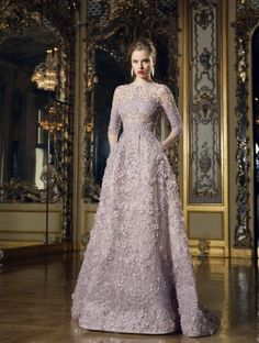 luxury evening images of women in dresses from Valentino, Chanel, Stephane Rolland, Armani Prive, Elie Saab, Zuhair Murad, Giambattista Valli, Georges Hobeika.
