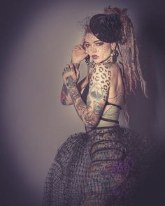 Model @morgin_riley wearing #JealousyJane couture photographed by @spectacularmoments photography in St. Louis  #fashiondesigner #girlswithtattoos #girlswithdreads #cageskirt #fascinator #goth #alternativegirl  www.jealousyjane.com  I love her. She is a little #katemoss and a little #Madonna