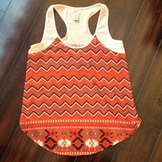 Aztec Tank Top Beautiful tank top with Aztec design. Love the colors! Perfect for warm weather. Great condition with no holes, stains, or tears. Eyelash Couture Tops Tank Tops