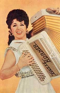 Yvette Horner – French Accordion Player. OMG I totally remember listening to an LP my parents had of hers when I was little. Still love it :)
