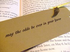 The Hunger Games - may the odds be ever in your favor - bookmark with mockingjay wing charm