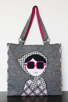 Saw this tote on patternpile.com. Sew Adorable!  PatternPile.com - Hundreds of Patterns for Making Handbags, Totes, Purses, Backpacks, Clutches, and more. | The Laura Tote – PDF   Handy Appliqué Techniques | http://patternpile.com/sewing-patterns