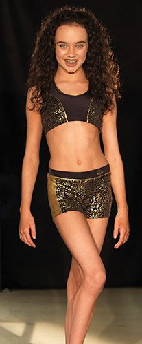 **NEW SPECIAL OFFER PRICE! ** Black Magic by 'Tayluer Made' Tayluer introduces this glamorous top and shorts set in a dazzling gold floral print Nylon/Lycra®.  The halter style crop top has gold foil lined ties to compliment the floral print and the shorts offer a wide comfortable waistband and flattering gold foil side panels. Both garments are printed with Tayluer's logo!