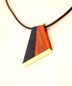 Gaboon Ebony, Burma Padauk and Brass pendant.