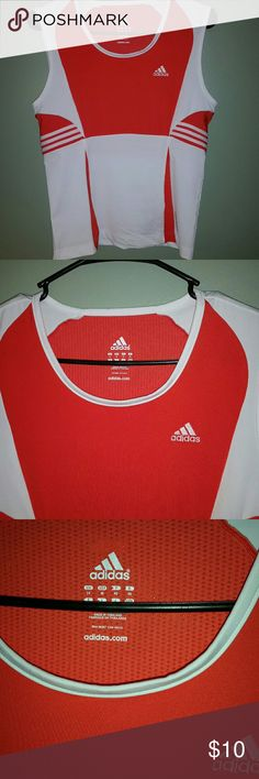 Adidas athletic tank top Adidas athletic tank top. Orangish red in color. Not as deep of a red as it looks in some of the pictures. Size medium. In excellent condition! Adidas Tops Tank Tops
