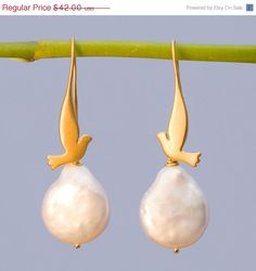 Hey, I found this really awesome Etsy listing at https://www.etsy.com/listing/91784589/sale-white-pearl-earrings-gold-dove