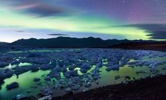 Aurora Borealis Over Icelands Jokulsarlon Glacier Lake. Also known as the Northern Lights, are light displays caused by solar winds emitted by the sun colliding with atoms of gasses in the Earth's atmosphere. One of nature's most spectacular light shows! Aurora Borealis, Glacier Lake, Iceland Glacier, Our Planet Earth, See The Northern Lights, Iceland Travel, Iceland Beach, New Travel, Travel Deals
