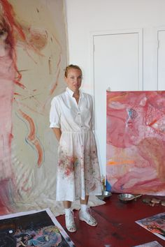 love the idea of a white dress customized as you paint and spill on it!  artist apparel smock idea rita ackermann