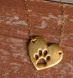 If someone with paws has left a mark on your heart, this is for you! I'm so getting one! http://theilovedogssite.com/product/gold-heart-paw/?src=PIN_GoldHeartPaw_3-18-14