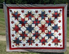 "Jason's July 4 Patriotic Star Birthday Quilt by Georgia Osterman at quilting.about.com modified pattern of ""Northwards Star"" designed by Anna Marie of MountainpeekCreations.com"