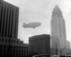 A Navy dirigible gathers smog samples in downtown Los Angeles, circa 1954. (Coy Watson Photos / LAPL 00050664)  Bizarre Los Angeles