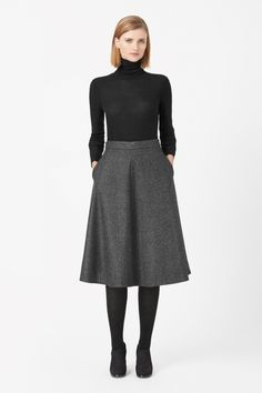 With a fine herringbone pattern, this flared circle-cut skirt is made from a blend of wool and cashmere with a loose silky lining. Designed to sit on the waist, it has a hidden back zip fastening and in-seam side pockets.