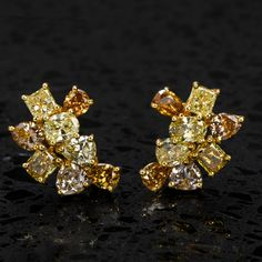 Add some gleaming beauty to your life with these elegant Fancy Diamond Multi color stud dold earrings. These alluring earrings boast 16 genuine natural Fancy color diamonds from light pink to Orange yellow , totaling 3.36 carats in total, Natural color, and VS clarity. Yellow Diamond Engagement Ring, Antique Engagement Rings, 18k Gold Earrings, Orange Yellow, Ear Piercings, Colored Diamonds, Clarity, Brooch, Fancy