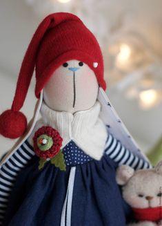 Купить или заказать Зимняя зайка  Ameli с медвежонком   - текстильная игрушка  38 см в интернет-магазине на Ярмарке Мастеров. Зайка Амели - яркая, милая и веселая !!! Это Рождество и Новый Год ! В лапке у Амели ее любимый медвежонок с новогодним бубенцом ( он сшит из флиса) . Сочетание синего в полосочку, синего в звездочки, синего с горошек , ярко-красного, белого, полосатые чулочки, колпачком с помпоном поддерживают скандинавский стиль :) Яркое, веселое украшение интерьера на Рождество и…
